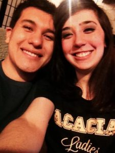 Alejandro and I smiling at a party, taking a selfie.