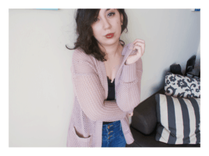 I'm wearing my pink cardigan and high waisted jeans.