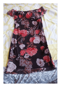 Floral bodycon dress laid out on my bed.