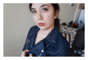I'm posing, wearing my navy blue leather jacket.