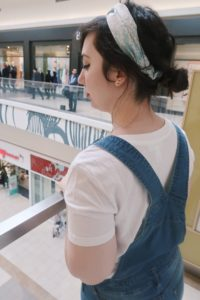 Wearing overalls, a white tee, and my blue patterned headband.