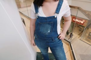Close up shot of my denim overalls and white tee.