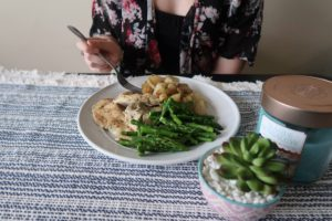 Eating my dinner: Italian chicken and potatoes, and asparagus.