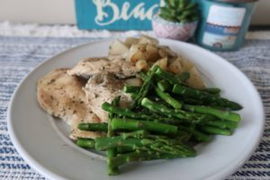 Plated Italian chicken and potatoes, and asparagus.