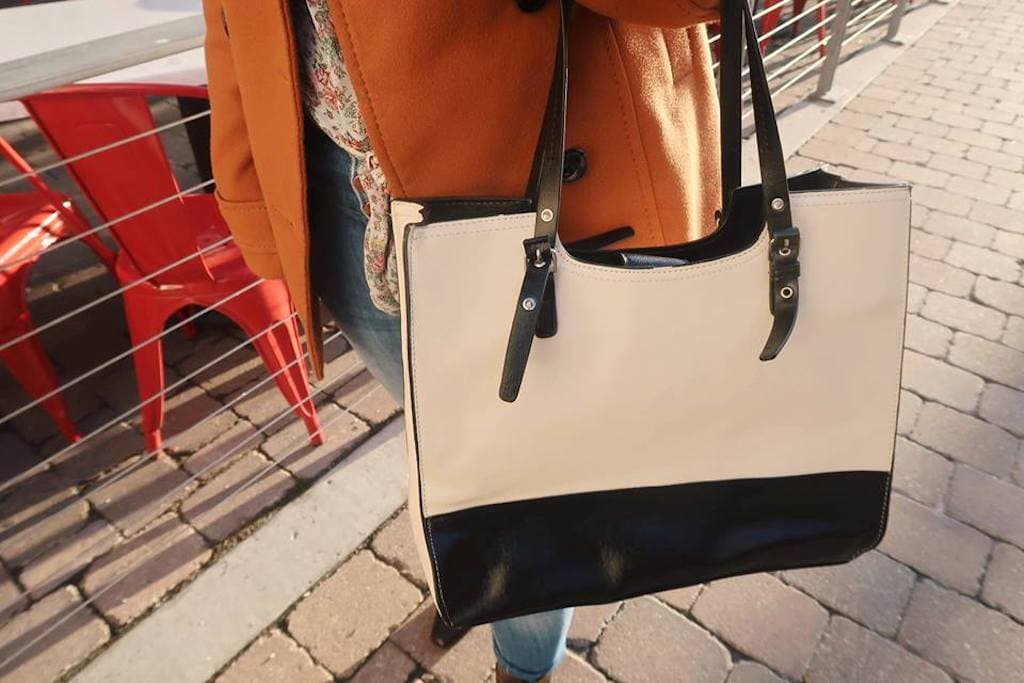 beige and black purse