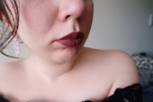 I'm wearing my Tarte Quick Dry Lip Paint in Obsessed.