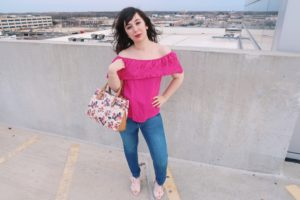 I'm wearing my pretty in pink outfit: a hot pink off-the-shoulder top and jeans, with pastel pink bow mules and floral purse.