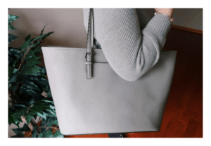 Grey Michael Kors tote bag.