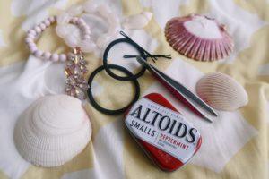 Altoids, bobby pins, hair ties, bracelets, earrings, and eyebrow tweezers.