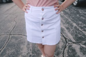 Close up of white mini skirt.