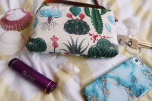 Cactus clutch, iPhone, keys, and portable charger - what's in my bag blog