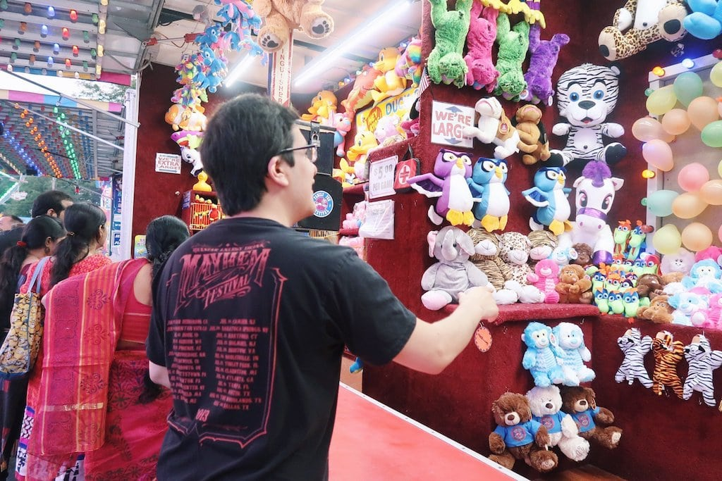 Alejandro playing carnival games.