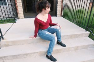 Charlotte Russe Outfit: v-neck top, ripped jeans, and black booties.