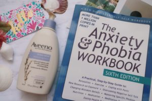 Aveeno Stress Relief Lotion and The Anxiety and Phobia Workbook Sixth Edition.