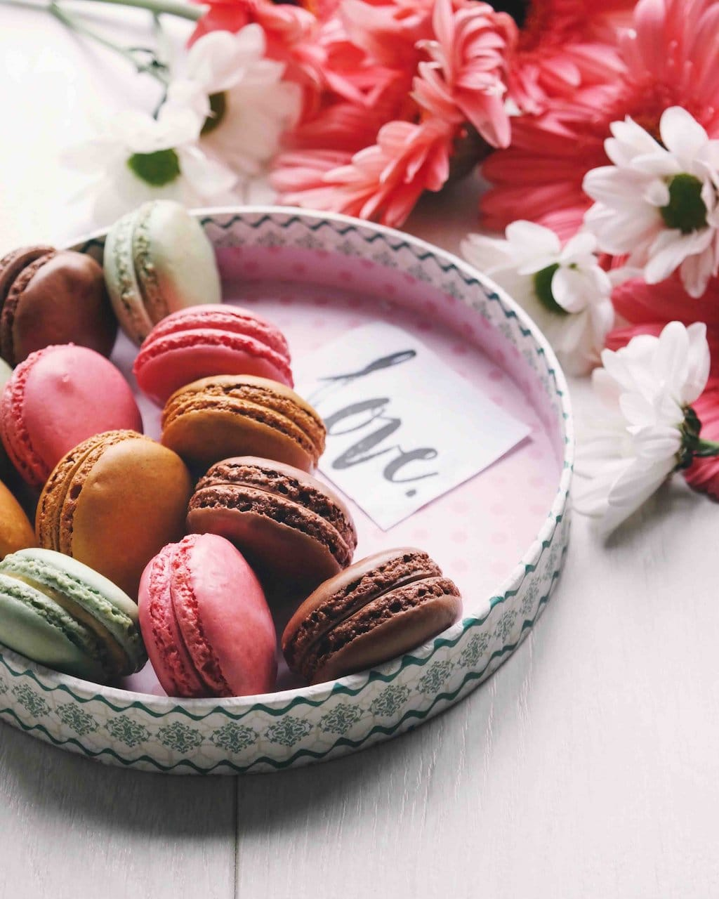 bowl of macaroons and flowers