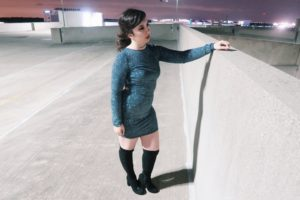 Wearing sequin bodycon dress with over the knee boots.
