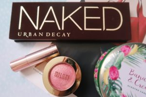 Assortment of cosmetic products - Urban Decay, Milani and Colourpop.