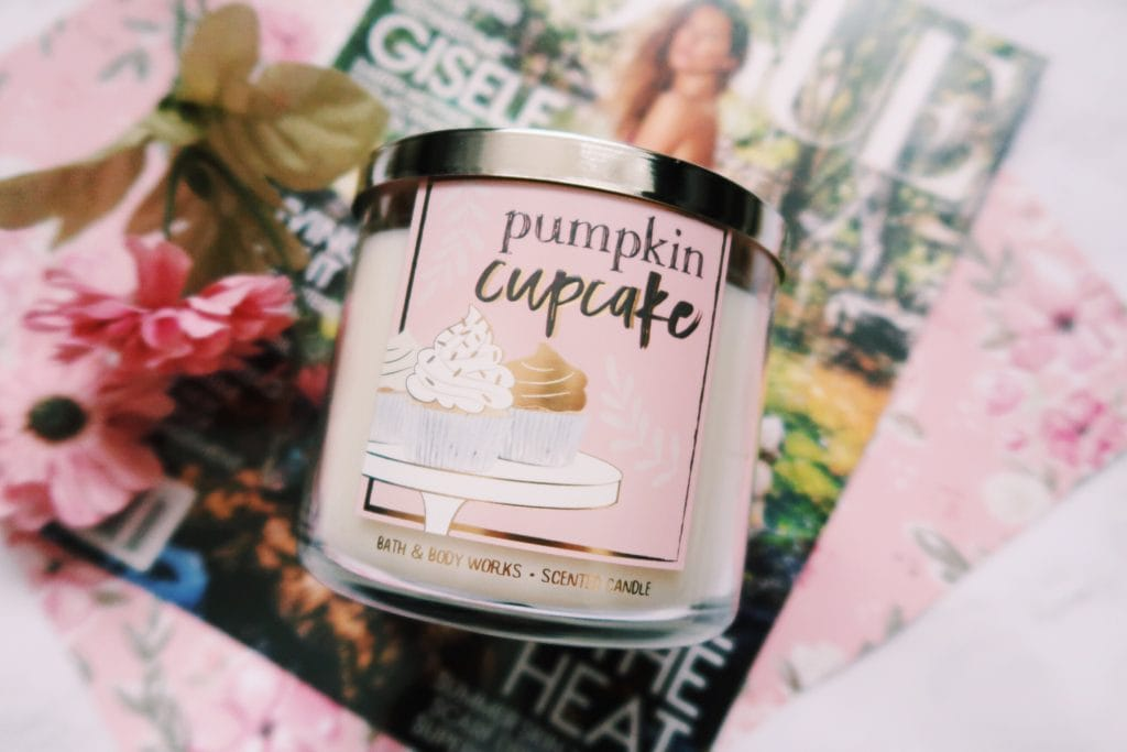 Bath and Body Works pumpkin cake candle and magazine flat lay.