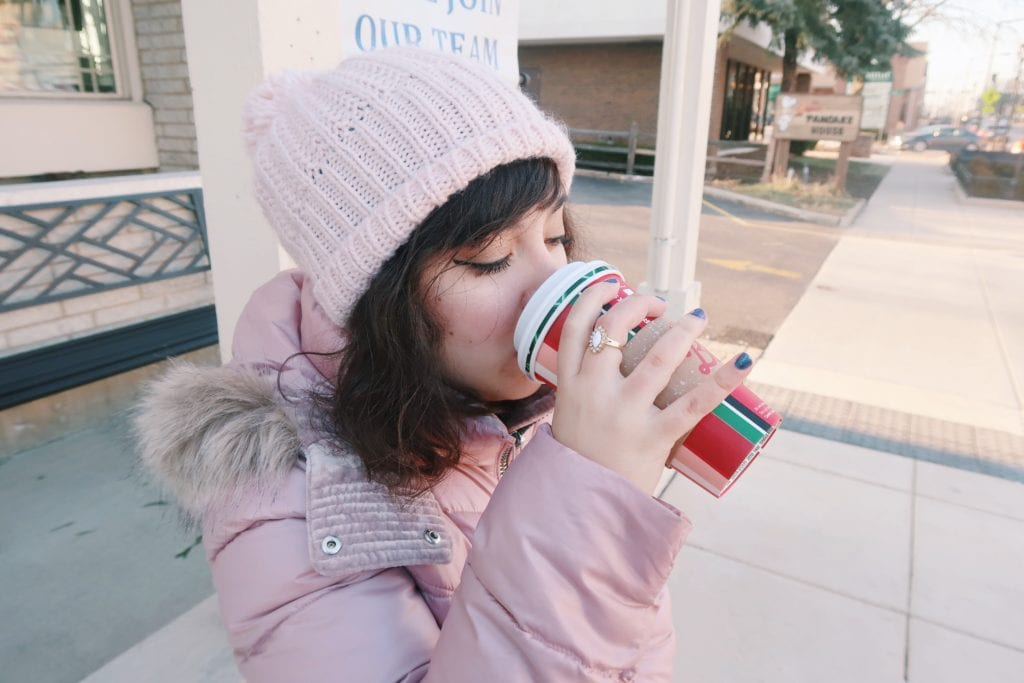Drinking Starbucks Holiday beverage, close-up.
