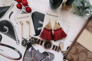 Jewelry display: black drop earrings and red tassel earrings