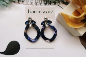 Jewelry Flat Lay: Blue drop earrings.