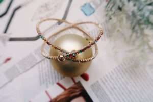 Jewelry Flat Lay: Rainbow crisscross bracelet.
