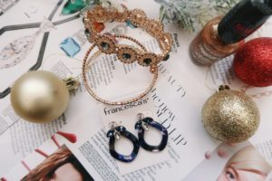 Jewelry Flat Lay: Bracelet assortment and blue drop earrings.