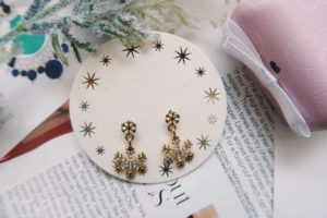 Jewelry Flat Lay: Snowflake earrings.