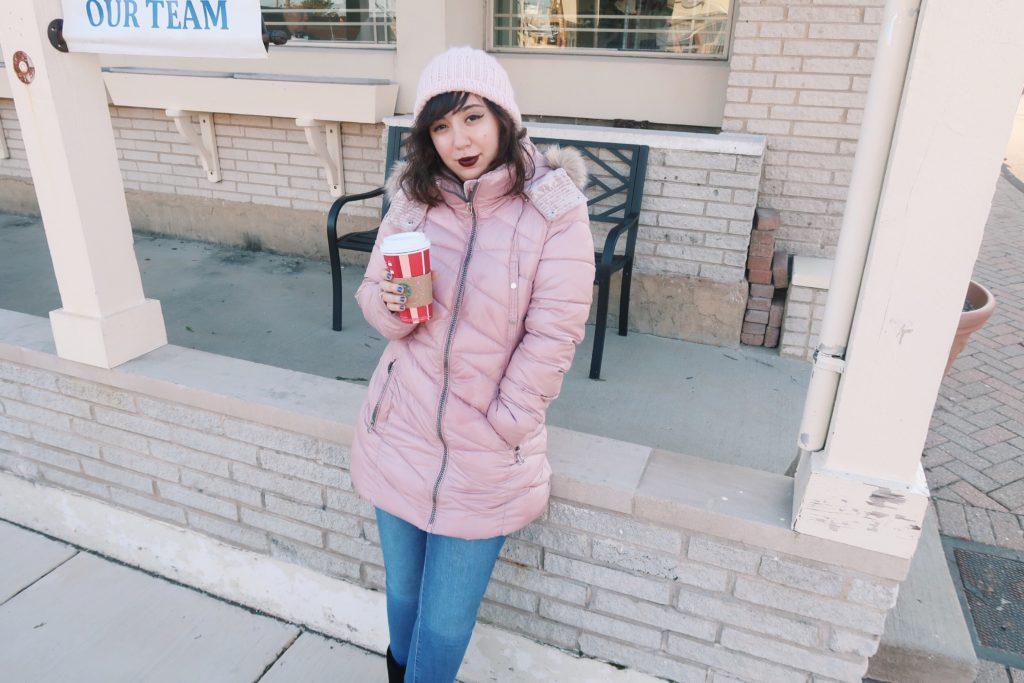 Holding Starbucks Holiday drink, Toasted White Chocolate Mocha.