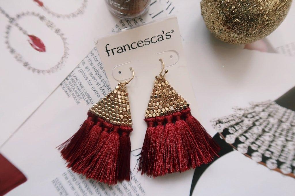 Red Tassel Earrings Flatlay