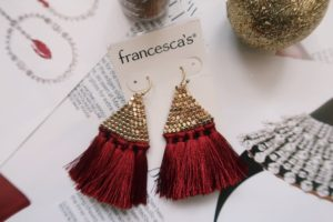 Red tassel earrings from Francesca's displayed.