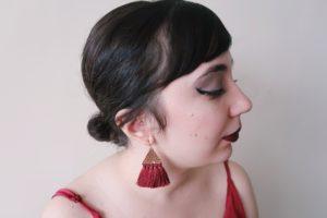 Wearing red tassel earrings from Francesca's - side profile.