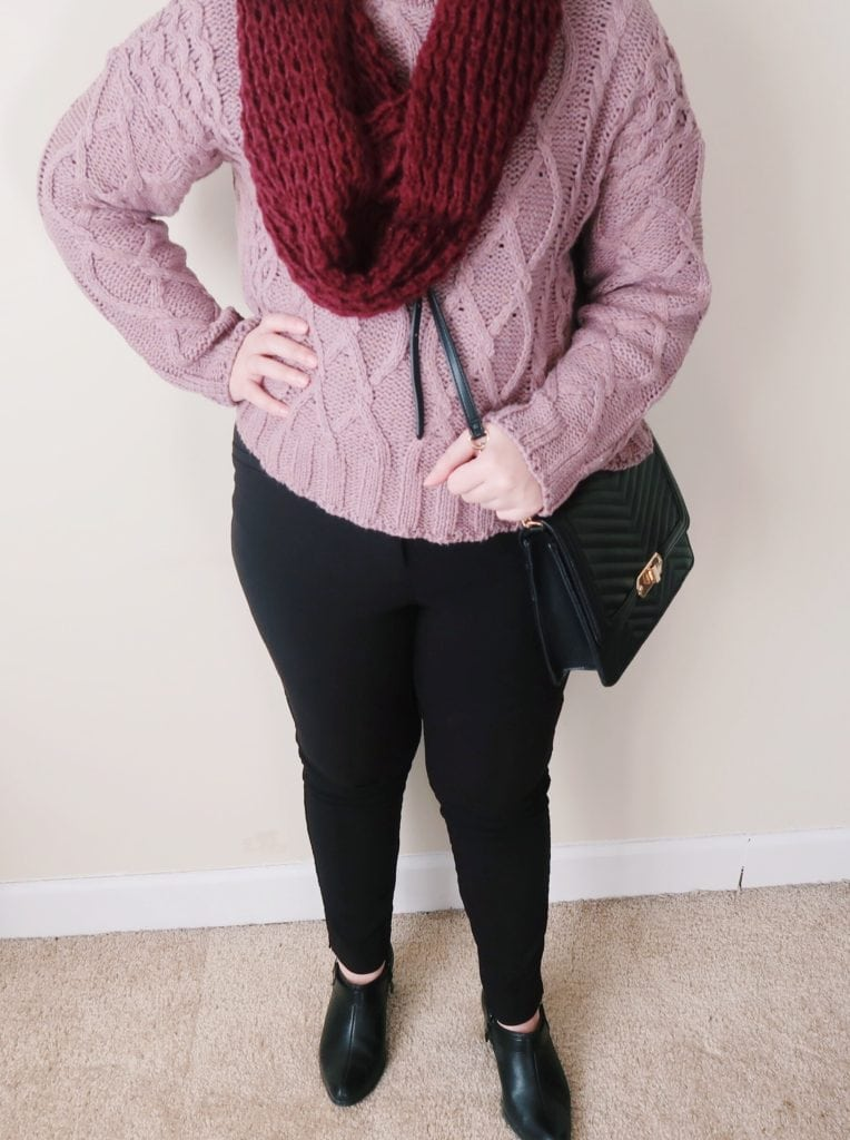 Purple knit pullover sweater and dressy black jeans.