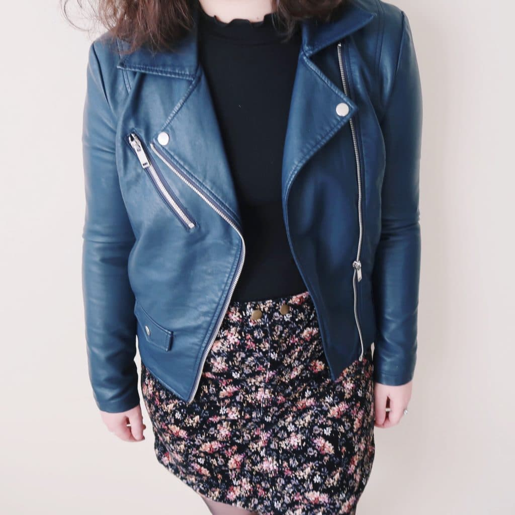 Leather jacket and floral corduroy skirt.