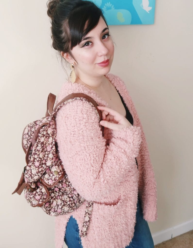Coffee Date Outfit: Wearing fuzzy pink cardigan, high waisted jeans, and floral backpack.