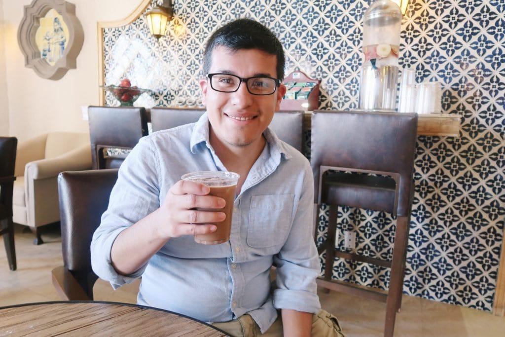 Alejandro enjoying coffee at the Coco Cafe.