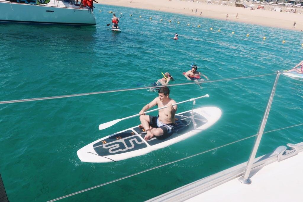 Alejandro paddle boarding.