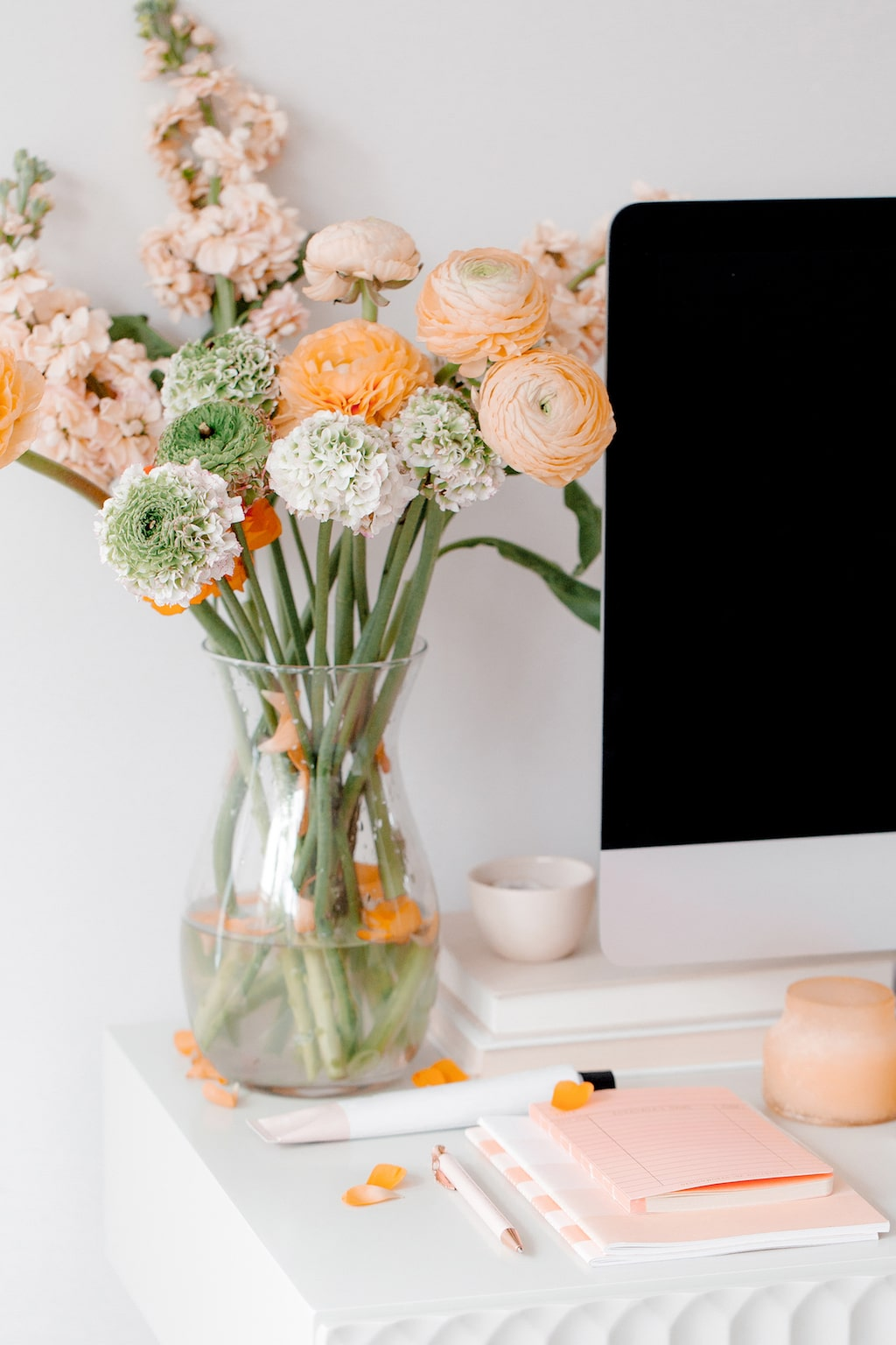Flowers and computer on a desk