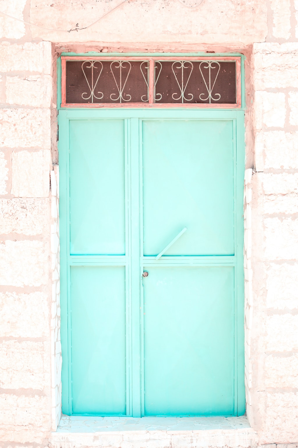 A mint/teal door.