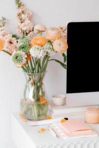 Pretty bouquet of ranunculus flowers on a desk.