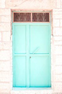 A mint/teal door.
