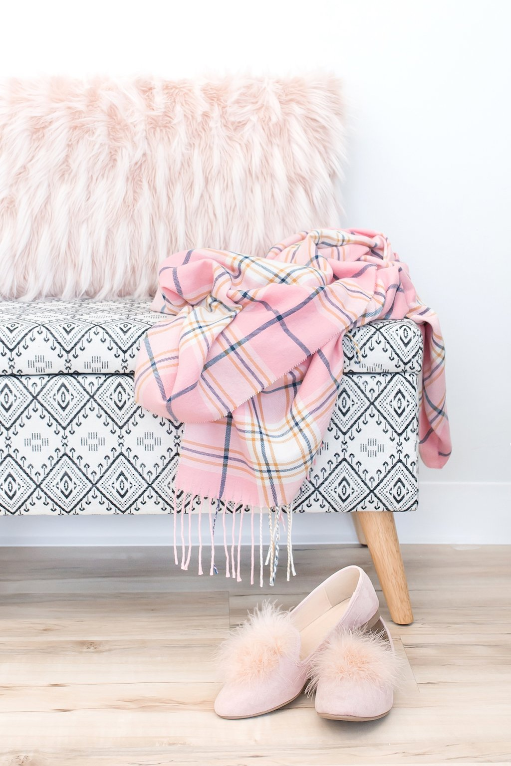 Chair, pink scarf, and slippers.