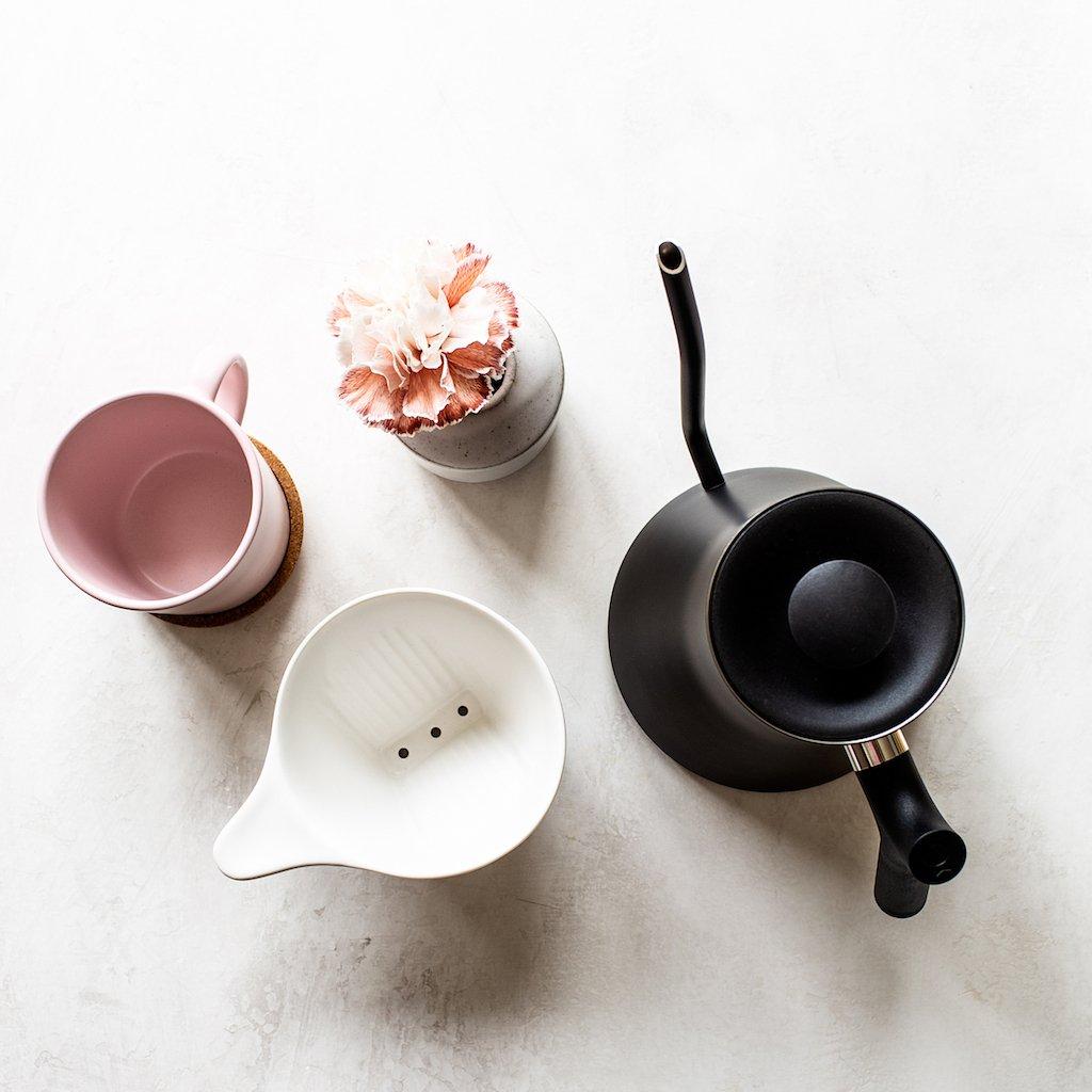 Preparing a warm cup of tea.