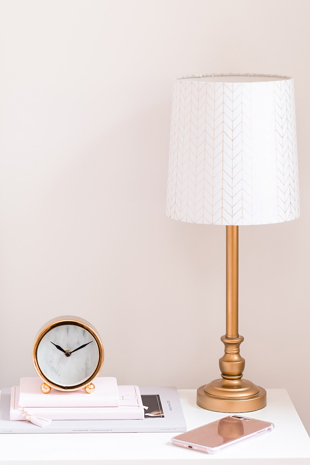 phone and clock on nightstand