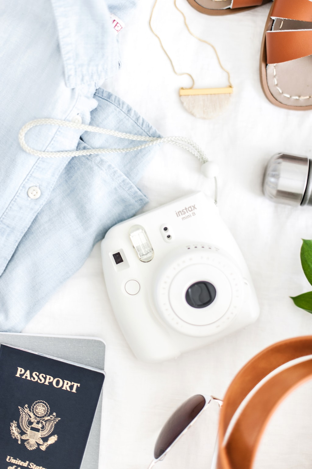 camera and clothes flatlay