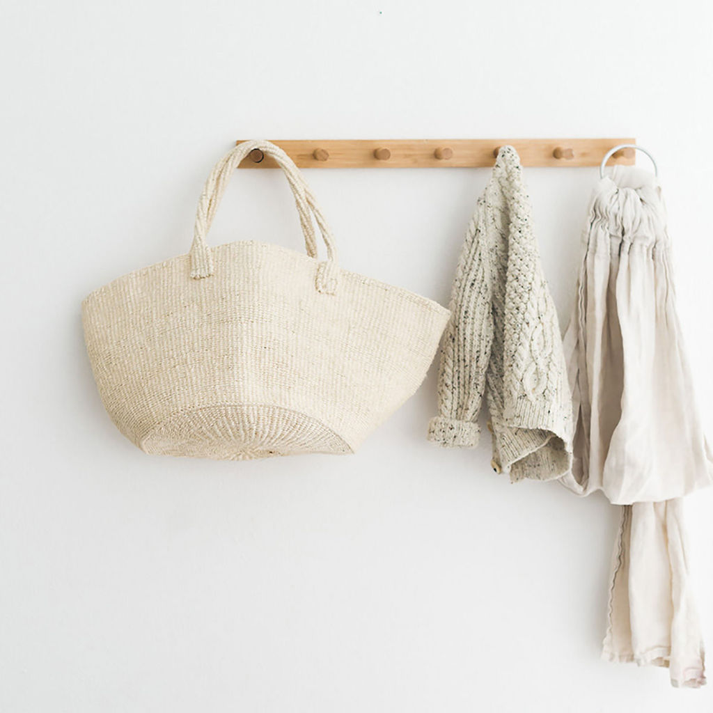 clothes and bag on rack