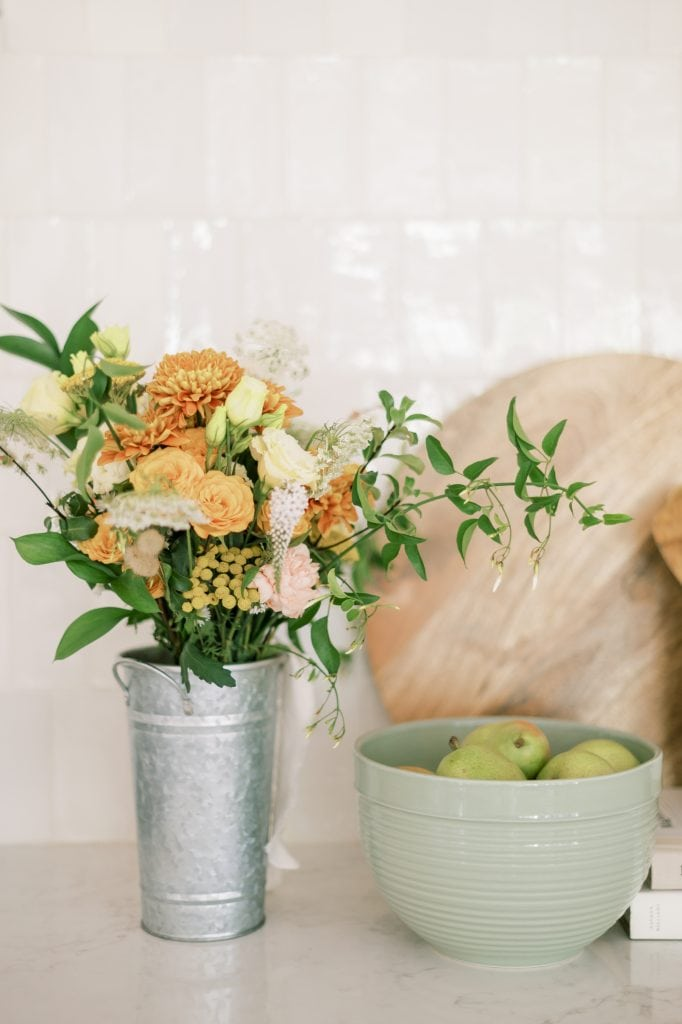 Spring Bucket List - Orange flowers and pears in a bowl